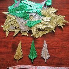 100 ASSORTMENT OF FOIL CHRISTMAS TREES