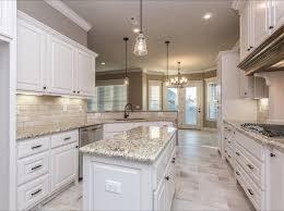 Spacious White Kitchen With Light Travertine Backsplash And Rectangular 12x24 Floor Tiles Lane Crosno Designs