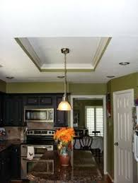 replacing 90 s fluorescent lighting box in kitchen to a modern
