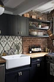 Black Farmhouse Kitchen With Exposed Brick Backsplash