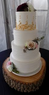 3 Tier Gold Scrolls And Rustic Buttercream Wedding Cake