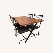 Solid Wood Dining Table W/ 4 Wrought-Iron Chairs - AptDeco Portrayal Of Wrought Iron Kitchen Table Ideas Glass Top Ding With Base Room Classic Chairs Tulip Ashley Dinette Set Zef Jam Outdoor Patio Fniture Black Metal Nz Kmart And Room Dazzling Round Tables For Sale Your Aspen Tree Cafe And Chic 3 Piece Bistro Sets Indoor Compact 2 Folding Chair W Back Wrought Iron Dancing Girls Crafts Google Search
