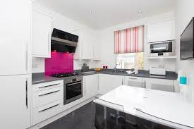 London Pink Kitchen With Contemporary Dish Racks And Wall Mounted Tv Gray Countertop