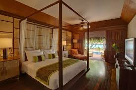 Stone Flooring Types For Charming Tropical Resort Design Bedroom With Wooden Bed White Mattress