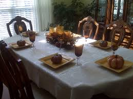 Candle Centerpieces For Dining Room Table by Brown Leaves And Brown Glass Candle Holder On Oval Dining Table