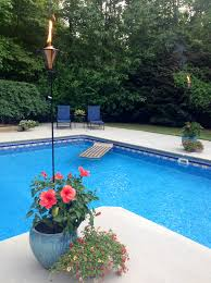 Tiki Torches In The Flowers Around The Pool | Inground Pools ... Outdoor Backyard Torches Tiki Torch Stand Lowes Propane Luau Tabletop Party Lights Walmartcom Lighting Alternatives For Your Next Spy Ideas Martha Stewart Amazoncom Tiki 1108471 Renaissance Patio Landscape With Stands View In Gallery Inspiring Metal Wedgelog Design Decorations Decor Decorating Tropical Tiki Torches Your Garden Backyard Yard Great Wine Bottle Easy Diy Video Itructions Bottle Urban Metal Torch In Bronze