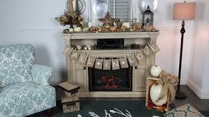Rustic Light Grey Wooden Stand Alone Fireplace With Thanksgiving Themed Decor