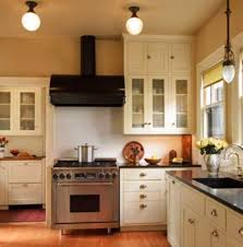 Countertops In The Kitchen Are Black Granite With A Honed Finish