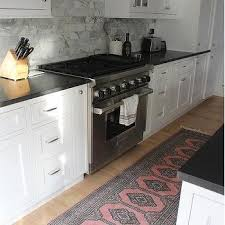 White Kitchen With Pink And Gray Runner