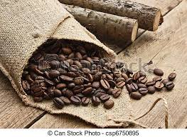 Coffee Beans In A Bag On Wooden Background