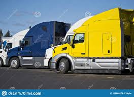 100 Simi Trucks Bright Big Rig Semi Standing In Row On Truck Stop In