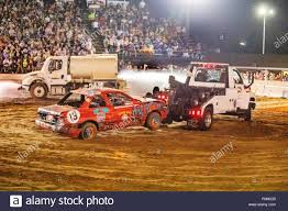 As A Water Truck Sprays Down The Arena, A Tow Truck Clears Out The ... Wrecked Truck During Demolition Derby Editorial Stock Photo Image Combine Local Driver Salary Trucks Pickup Truck Demolition Derby Youtube Douglas County Winners Crowned Herald Q927 Wqel Nice Day For A Drive At Anoka Fair Star Cummins In Dodge Diesel Dresden 2015 Pro Mod Action Auto Demo Fairgrounds Driveshaft Ejected Into Crowd Three Injured Cars And After