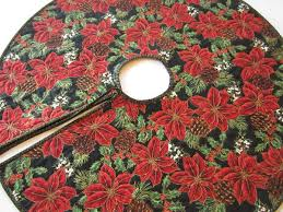 Christmas Tree Skirt With Poinsettias And Pine Cones On A Black Background