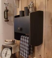 primitive bathroom cabinet towel rack toilet paper storage