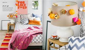 A Modern Girls Bedroom Decorated In Pink Orange White And Black Is Featured