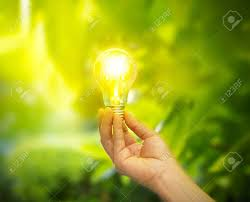 holding a light bulb with energy on fresh green nature