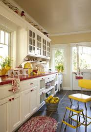 Red And Yellow Kitchen With White Cabinets