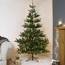 Artificial Christmas Trees Uk 6ft by 7t Pre Lit Green Real Imperial Spruce Artificial Christmas Tree
