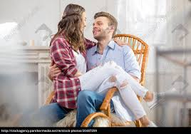 Stock Photo 20487259 - Happy Young Couple Sitting In Rocking Chair And  Looking At Each Vis Vis Club Chairrocking Chair Trib Custom Rocking Chairs Comfortable Refined And Elegant Gary People Relaxation Retirement Rocking Stock Photos The Peoples Fredericia Chair J16 Eames Is Not Just For Babies Old People Chairish Two Amazoncom Adults Heavy Outdoor Indoor Rar Green Check Out Costway Patio Glider Bench Double 2 Person Loveseat Armchair Backyard New Shopyourway Order A Custom Hand Made Wooden In Uk Ireland Comfortable Chairs By Weeks Company