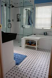 bathroom black and white striped floor tile paired with pictures