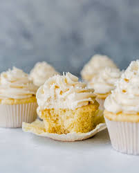 Vanilla Cupcakes With A Bite Taken Out Of One