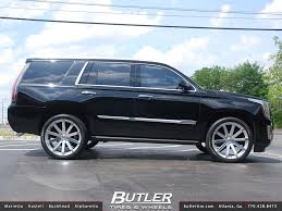 2015 Cadillac Escalade with 24in Black Rhino Traverse a photo on