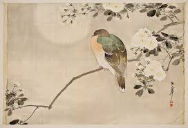 Bird Perched On Blossoming Branch