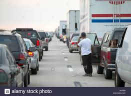 Man On Cell Phone Looks Down Row Of Cars And Trucks Stopped In A ... Cars And Trucks For Kids Learn Colors Vehicles Video Coloring Pages Of Cars And Trucks Cstruction Images Toy Pictures 2016 Amazoncom Counting Rookie Toddlers Wallpaper Top 10 The Best Of The 2017 Cars Trucks Los Angeles Times Other Real Pictures Apk 30 Download Free Education Kn Printable For Kids New Used In Jersey City Amazing Sale By Owner Texas Luxury Craigslist San Antonio Tx Image Truck Kusaboshicom