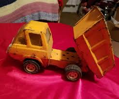 VINTAGE TONKA METAL Dump Truck Yellow Toy Small Pressed Steel - Rare ... Find More Large Metal Tonka Dump Truck For Sale At Up To 90 Off Classic Steel Mighty Backhoe Cstruction Toy Northern Tool Lot Of 3 Toys Nylint Chevy Tonka Bull Dozer Vintage 1970s Mighty Diesel Yellow Estate Big W Reserved Meghan Vintage Green Haul Trucks 1999 Awesome Collection From Trucks Metal 90s 2600 Pclick Pressed Toys Dump Truck