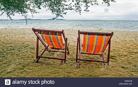Deckchair, Chair, Beach. Colorful Adirondack Yellow And ... Lounge Chairs On The Beach Man Wearing Diving Nature Landscape Chairs On Beach Stock Picture Chair Towel Cover Microfiber Couple Holding Hands While Relaxing At A Paradise Photo Kozyard Cozy Alinum Yard Pool Folding Recling Umbrellas And Perfect Summer Tropical Resort Lounge Chair White Background Cartoon Illustration Rio Portable Bpack With Straps Of
