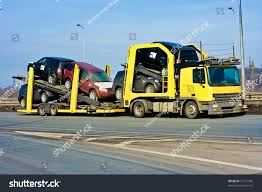 Car Carrier Truck Stock Photo (Royalty Free) 21217396 - Shutterstock New Cars Vehicle Carrier Transport Trailer Truck Stock Video Footage Cheap Toy Truck Car Find Deals On 8x4 Heavy Duty Cement Bulk 30m3 Tank Volume Lhd Rhd China 5 Ton Medium Low Bed For Eeering Machine Faw Sale In Malaysia Flatbed Buy Ltl Carrier A Duie Pyle Sees Growth In Expited Shipping Shop Costway Portable Container 8 Pcs Alloy Filehts Systems Hts Hand Racksjpg Wikimedia Commons Daesung Plastic Motor With 2 Minicar Crete And Shaffer Otr Drivers Get Pay Hike Trucking Yellow With Raised Ramp Photo Picture And Semi Transporter Trailer Race Auto Hauler