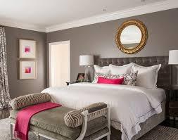 bedroom pink cushions pink highlight gray wall golden mirror