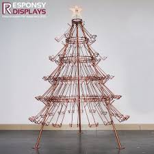 China Attractive Design Golden Christmas Tree Beer Display Metal Wire Floor Wine Rack