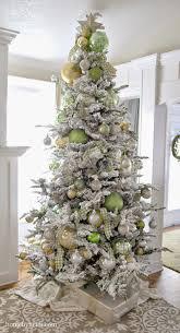 Slim Snow Flocked Christmas Tree by How Decorate A Christmas Tree With Ribbon Christmas Lights