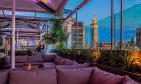 The Best Rooftop Bars In NYC | The Ultimate Guide To Drinks With A ... Nondouchey Rooftop Bars For The Best Outdoor Drking Rooftop Bars In Midtown Nyc Gansevoort 230 Fifths Igloos Youtube Escape Freezing Weather This Weekend Nycs Best Enclosed Phd Terrace Opens At Dream Hotel Wwd 8 Awesome New York City Of 2015 Smash 01 Ink48 Bar With Mhattan Skyline Behind Press Lounge Premier Enjoying Haven Nightlife Times Squatheatre District Lounges Spectacular Views Cbs 10 To Explore Summer Bar Rooftops