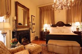 Large Elegant Guest Dark Wood Floor Bedroom Photo In New Orleans With Beige Walls A