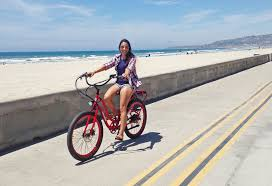 Bianca Rides A Pedego Electric Bike On The Boardwalk In Mission Beach