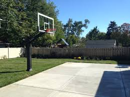 There Is The Hoop On The Side Of The Driveway In His Fenced Front ... Backyard Basketball Court Utah Lighting For Photo On Amusing Ball Going Through Basket Hoop In Backyard Amateur Sketball Tennis Multi Use Courts L Dhayes Dream Half Goal Installation Expert Service Blog Dream Court Goals Atlanta Metro Area Picture Fixed On Brick Wall A Stock Dimeions Home Hoops Gallery Sport The Pinterest Platinum System Belongs The Portable Archives Bestoutdoorbasketball Amazoncom Lifetime 1221 Pro Height Adjustable