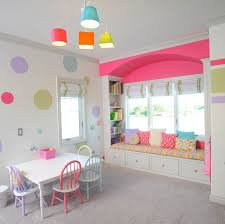 Comely Kids Playroom Design Inspiration With Colorful Dining Chairs And Rectangle White Table Plus Bay Window Seat On Grey Covered Floor