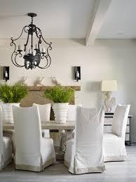 Custom Dining Chair Slipcovers Black Wrought Iron Chandelier Light Wood Floors