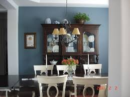 Charming Dining Room Design With Blue Wall Color And Wooden Glass Wardrobe Also Antique Black Chandelier Decor Idea