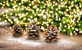Pine Cone And Christmas Tree Branches With Lights Decoration Royalty Free Stock Photos