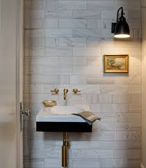 Kohler Purist Faucet Gold by Beautiful Powder Room With Marble Subway Tile Backsplash And