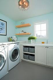 turquoise laundry room with gray tiled floors contemporary