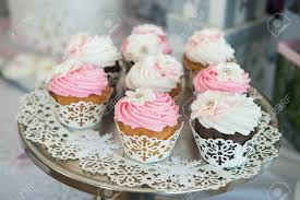Cupcaces On Plate Buffet Table Colorful Beautiful Cupcakes With Cream Stock Photo