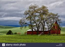 USA, Washington, The Palouse. Red Barn Under Stormy Skies In Field ... Red Barn Washington Landscape Pictures Pinterest Barns Original Boeing Airplane Company Building Museum The The Manufacturing Plant Exterior Of A Red Barn In Palouse Farmland Spring Uniontown Ewan Area Usa Stock Photo Royalty And White Fence State Seattle Flight Interior Hip Roof Rural Pasture Land White Fence On Olympic Pensinula