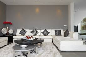 Dark Grey Living Room With White Sectional Couch And Black Coffee Table