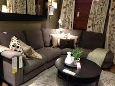 this ikea tidafors sofa looks great with colourful cushions and
