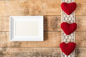 Stock Photo Three Knitted Red Hearts On Lace Wooden Rustic Background With White Frame