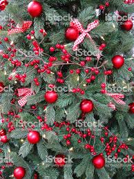 Artificial Christmas Tree With Red Decorations Baubles Berries Ribbon Bows Royalty Free
